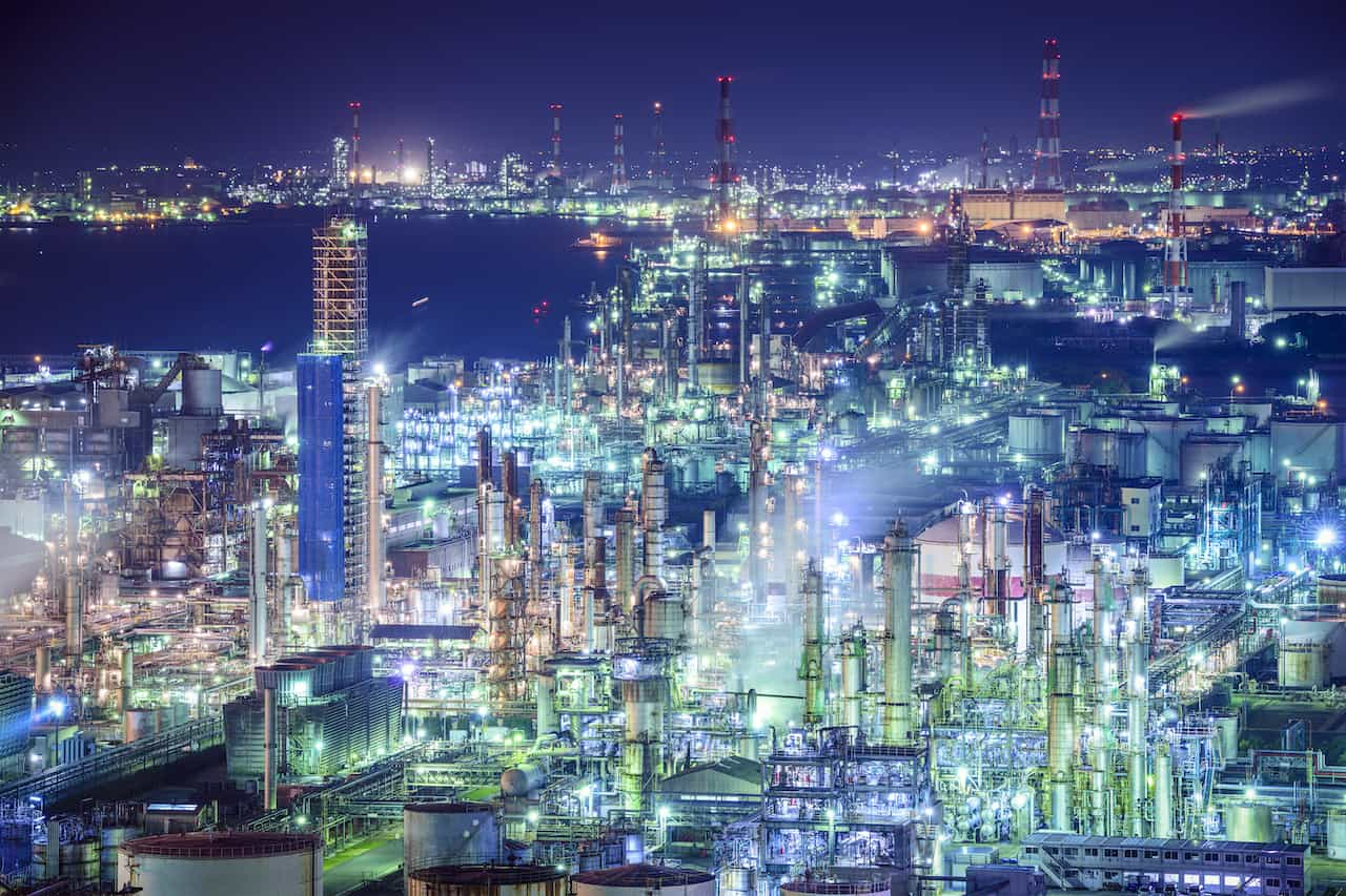 Multi-site multi-plant industrial manufacturing night skyline