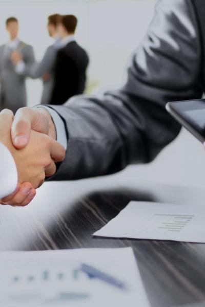 Partnership closeup of two businessmen shaking hands