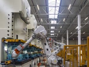 Industrial robots in a production line in a manufacturing facility